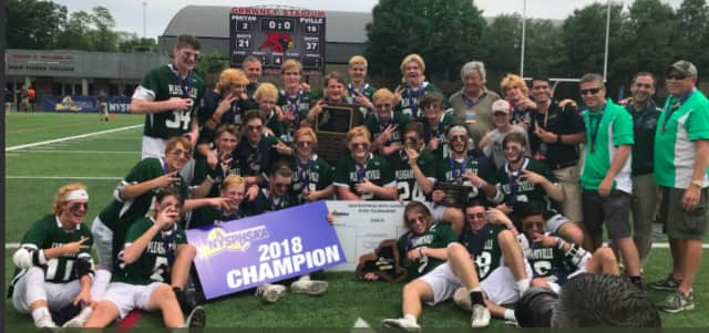 Pleasantville's boys lacrosse team celebrates the first state championship in school history, a 16-2 win over Penn Yan on Saturday.