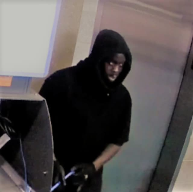 An African American suspect was caught on camera allegedly robbing parking machines and an ATM in Norwalk.
