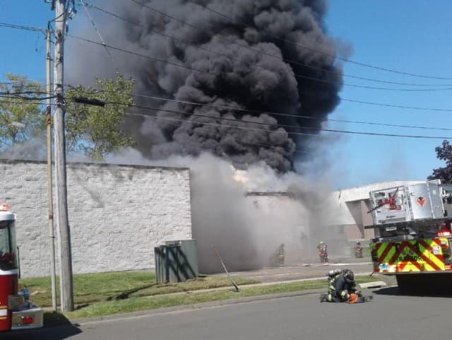 Roof Collapses After Fire Breaks Out At Medical Company In