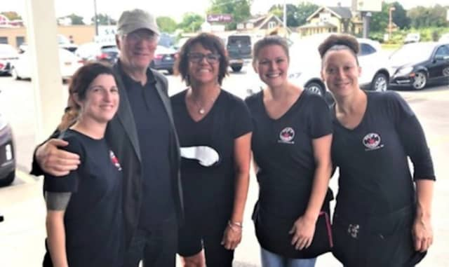Actor Richard Gere poses for a photo with the staff at Julie's Diner on Saturday. From left, Jeanette Bova, Gere, diner owner Kristen Macko, Megan Skinner and Jen Cruz.