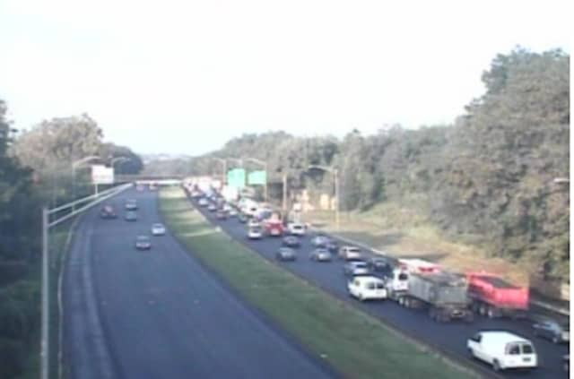 Traffic on I-95, with the southbound side on the right.