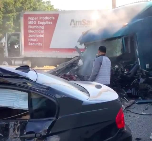 The eastbound tractor-trailer plowed through the median and slammed into a BMW and Freightliner headed toward it in the westbound lanes, authorities said.
