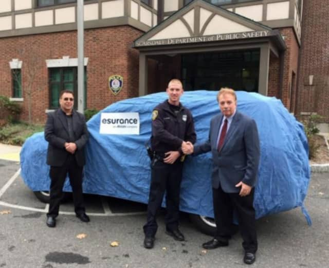 Esurance Senior SIU Major Case Investigator Michael Sepanara (left) Esurance SIU Investigator
