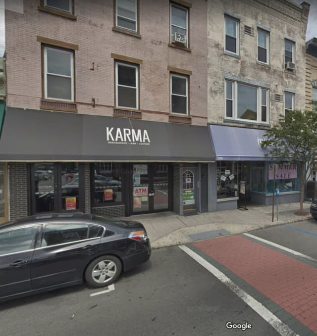 A woman punched a cop during a fight in from of the Karma Lounge.