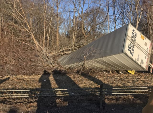 The driver of a tractor-trailer was killed after crashing his truck.
