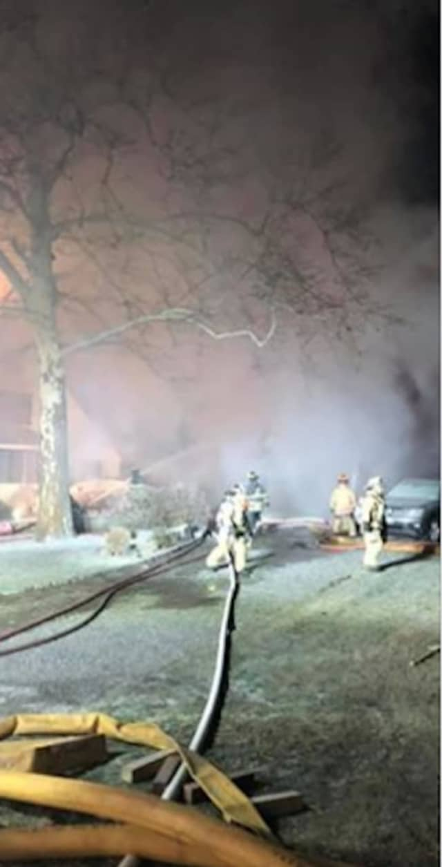 Firefighters from multiple municipalities battled the three-alarm blaze on Mamaroneck Road in Scarsdale.