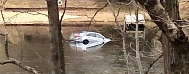 A car rolled into Mt. Kemble Lake Wednesday.
