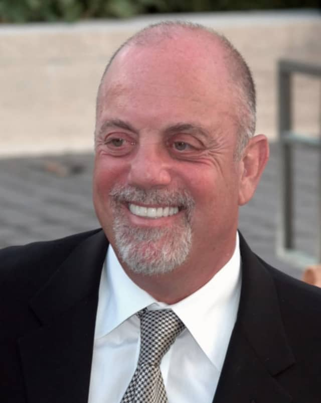 Billy Joel still has his Long Island accent and lives there too.