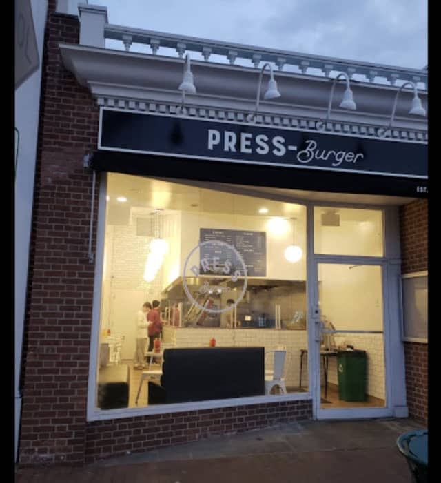 A man was arrested after causing a disturbance at Press Burger.