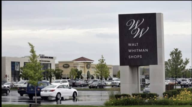 A police officer and two others were injured during a crash in front of Walt Whitman Mall.