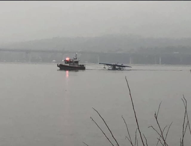 A look at the small plane being towed to the Tarrytown Marina.