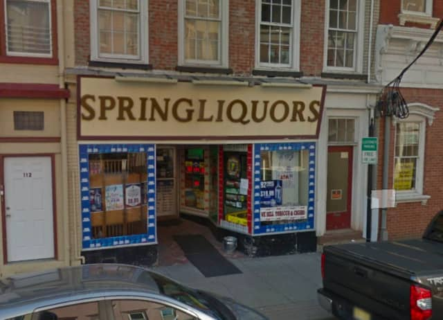 The incident occurred outside of Spring Liquors in Newton.