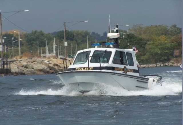 Police aboard Westport Marine 1 was used in the rescue of four men clinging to a partially submerged boat that was spotted by a nearby oyster boat Tuesday, June 18 in the Long Island Sound near Peck's Ledge Lighthouse.