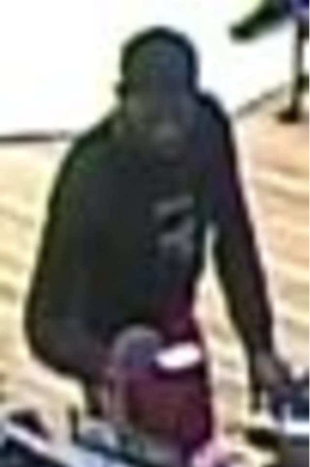 Police are on the lookout for a man suspected of charging two purchases to a bank account that did not belong to him at the Smith Haven Mall Macy's on Tuesday, May 14 around 1:15 p.m.