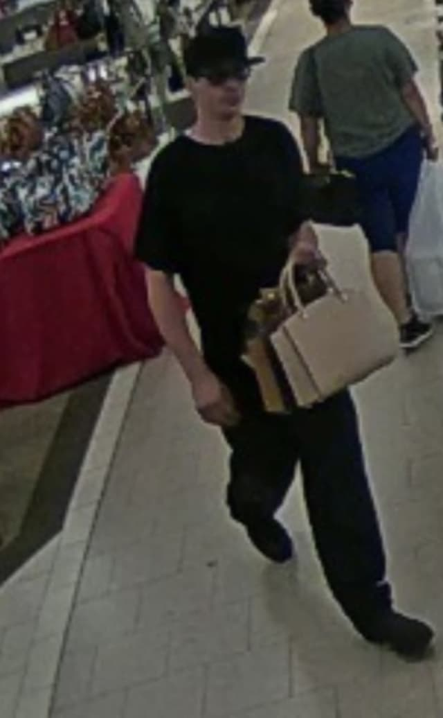 Suffolk County Crime Stoppers released a photo of a man who allegedly stole three handbags from the Macy's at the Smith Haven Mall.
