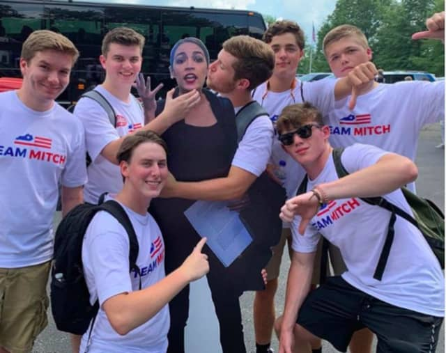 Team Mitch youths in Senate Republican Leader Mitch McConnell's home state of Kentucky generated a Twitter firestorm with their selfie taken with a replica of U.S. Rep. Alexandria Ocasio-Cortez.