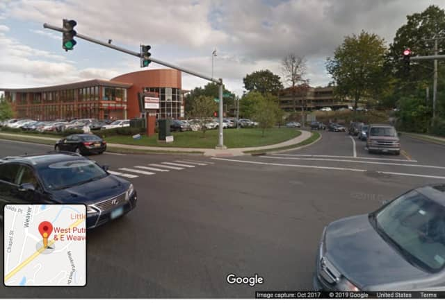 A drunk driver reportedly fell asleep while stopped at this intersection's red light, according to Greenwich Police.