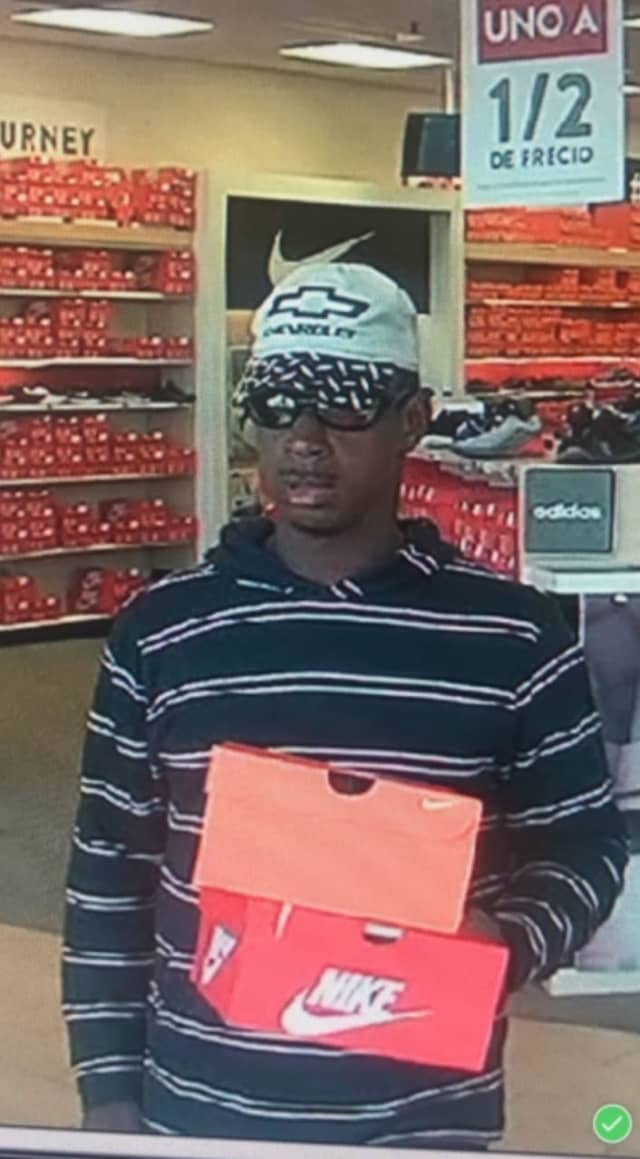 Police have released a surveillance photo of a man caught stealing sneakers from a store in Islandia.