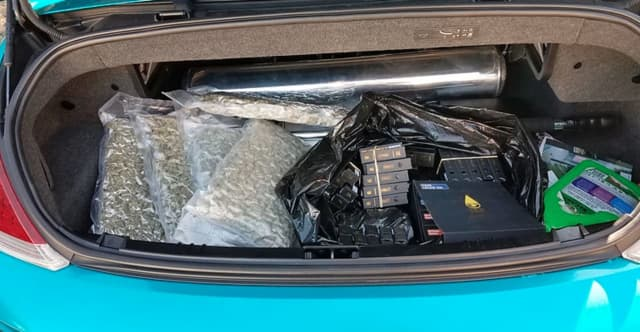 Sean Bell, 26, of Patchogue was charged after police say he was found to be in possession of 150 flavored vape cartridges containing THC and approximately 2.5 pounds of marijuana located in five vacuum-sealed bags in the trunk.
