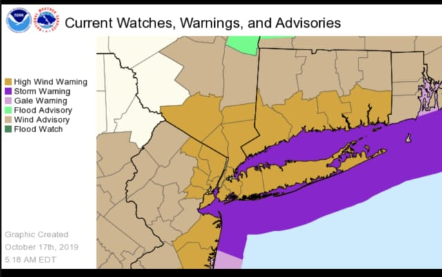 A High Wind Warning is in effect for areas shown in brown.