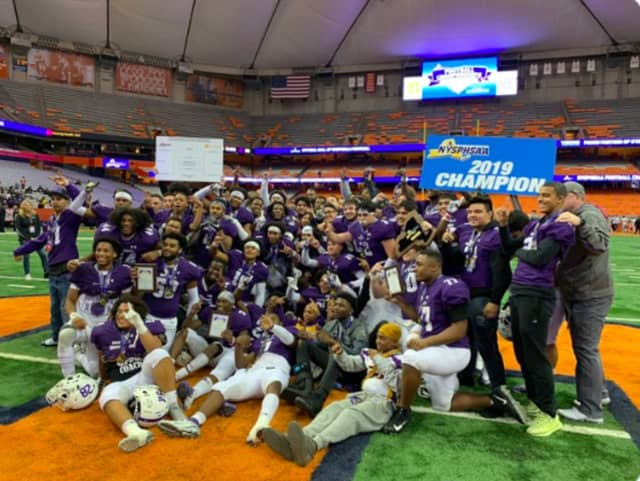 New Rochelle High School celebrates its 28-0 win over McQuaid of Rochester in the Class AA state title game in Syracuse on Saturday night, Nov. 30.