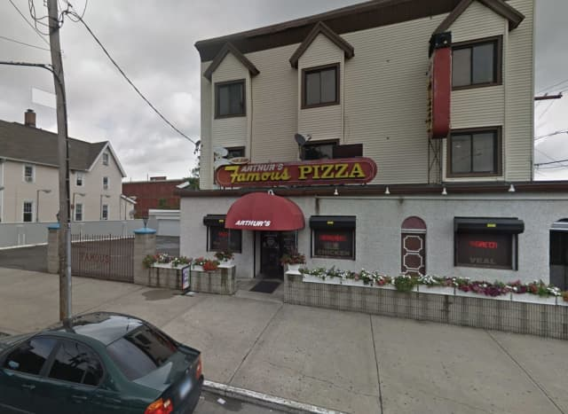 An armed, masked attempting to rob a restaurant fled when he saw a police officer inside.