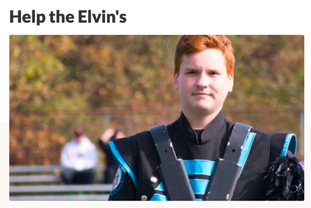 William Elvin, a Parsippany Hills HS student and marching band member, has help from teacher Michael Iapicca in recovering from the house fire that displaced his family on Dec. 5.