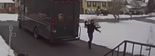 A UPS driver was caught on camera haphazardly tossing a package he was delivering at a Connecticut home.