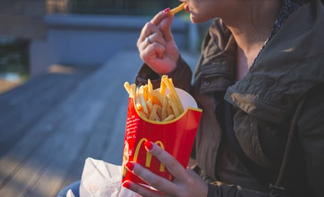 Damaged crops may result in a shortage of French fries in the coming year, according to Bloomberg.