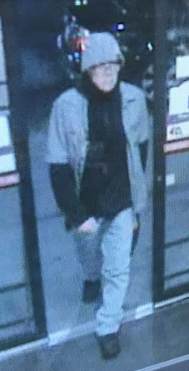 Police in Nassau County are attempting to locate a man who allegedly robbed a bank.