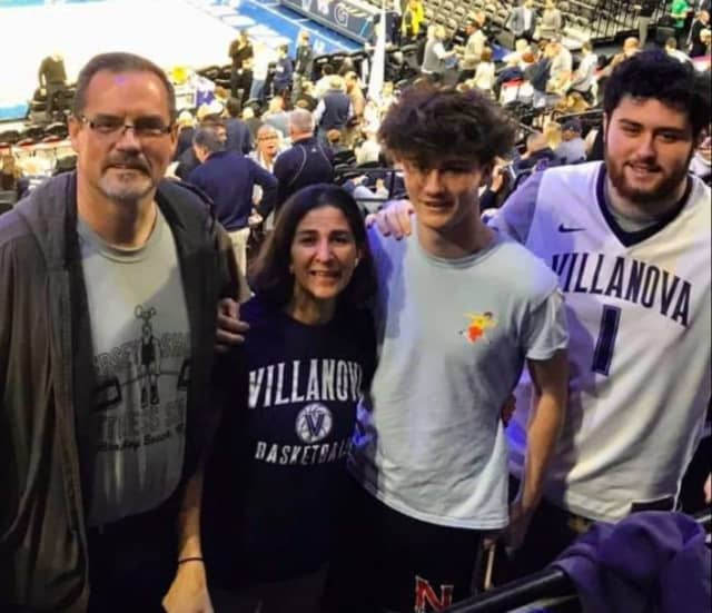 Susan Antoon Cousins with her husband, Gordon, and their teenage sons, Seth and Luke.