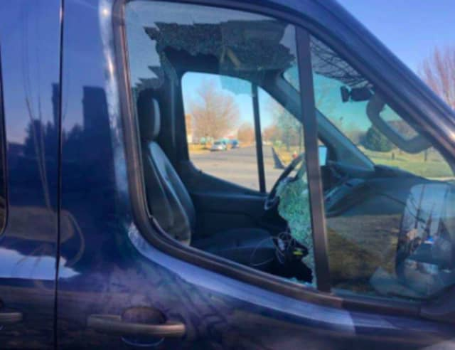 A brick was thrown through a truck window during a road rage incident, injuring the driver.