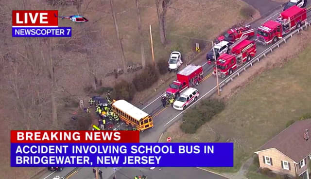 Three people were hospitalized in a crash involving two cars and a school bus Thursday in Bridgewater, reports say.