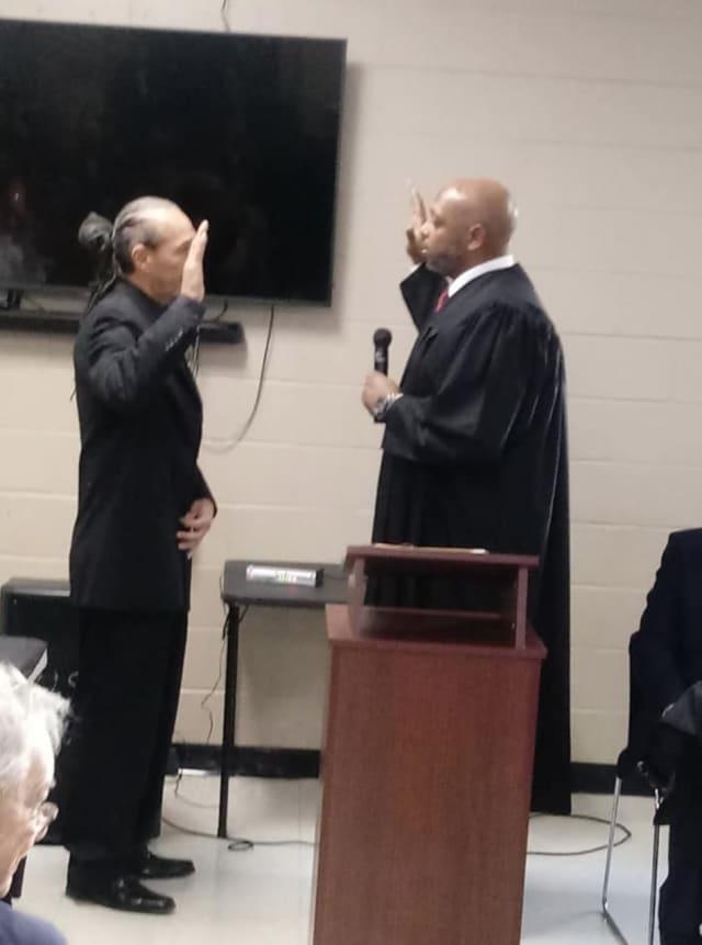 Omari Shakur (left) being sworn in as Newburgh City Councilman in November.