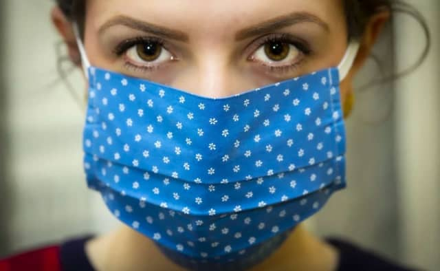 Federal officials are reviewing their recommendations on wearing face masks in public to prevent the spread of COVID-19.