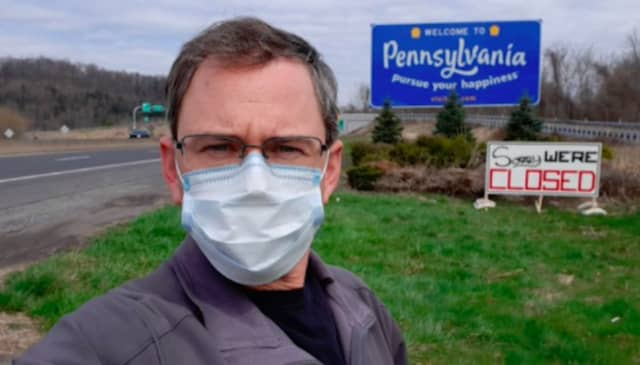 """""""Sorry We're Closed,"""" a sign reads along I-80 at the New Jersey-Pennsylvania state line."""