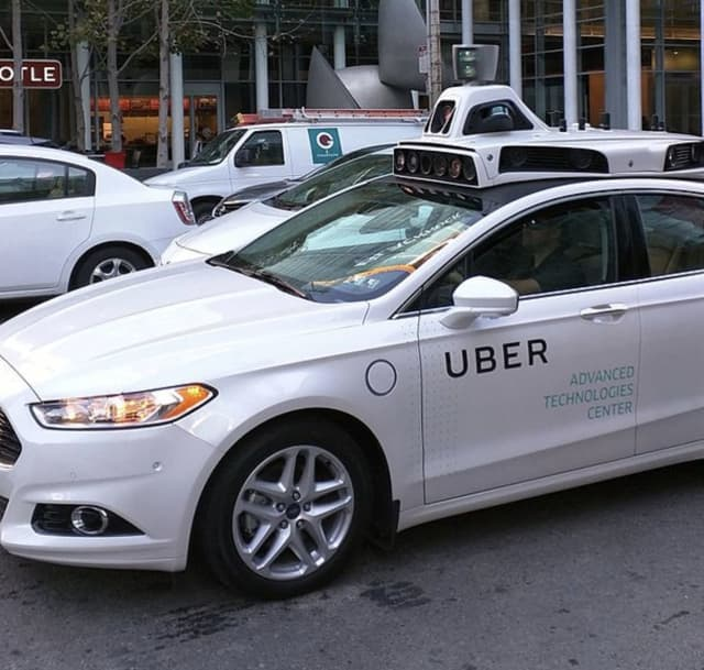 An Uber driver was robbed and attacked by two men posing as police.