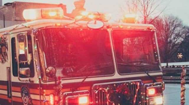 About 150 firefighters from 14 departments responded to a three-alarm fire that broke out a Long Island business.