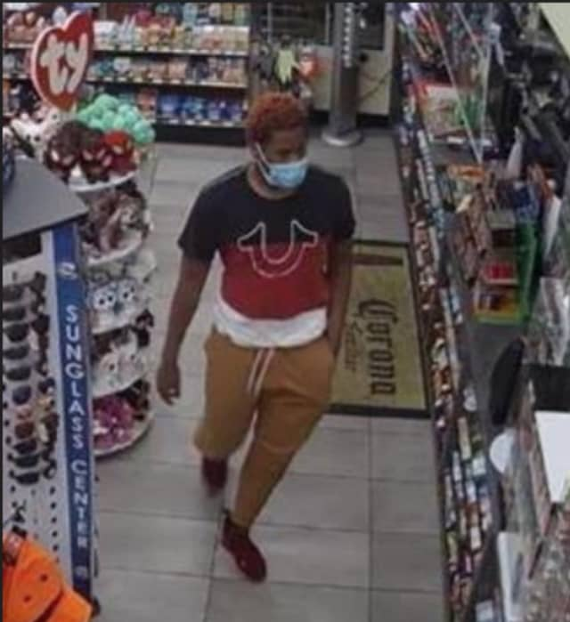 A man is wanted after allegedly stealing from a display case at Shell gas station in Port Jefferson.