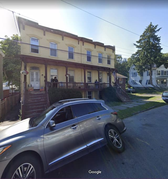 A woman was found dead inside a basement apartment during a three-alarm fire.