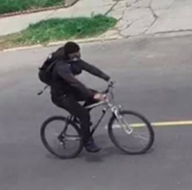 Authorities are seeking the public's help identifying a man they say stole a woman's purse while riding a bicycle in Newark.