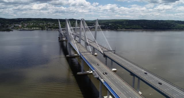 A woman was saved by a Good Samaritan and a tow truck driver after attempting to jump from the new Tappan Zee Bridge.