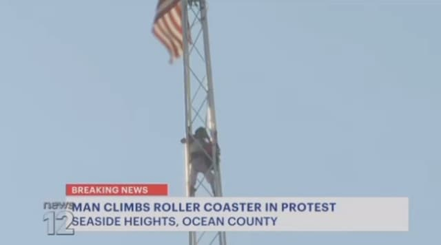 "Man named ""Chris"" atop Casino Pier ""Skyscraper"" tower ride at Casino Pier in Seaside Heights."
