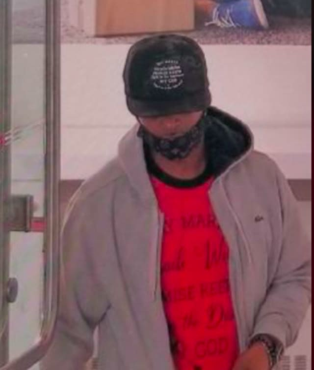 This man is accused of spitting in the face of a bank worker who asked him to adjust his face mask.