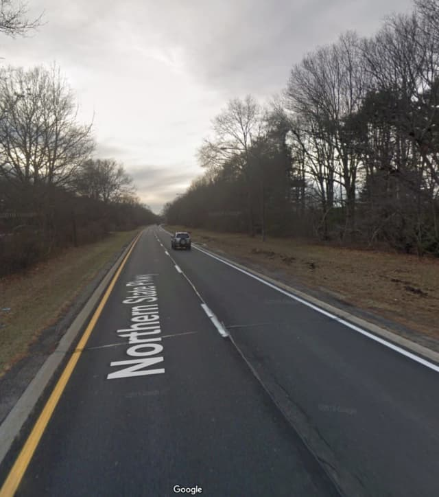 A live cat was thrown from a moving vehicle on Northern State Parkway between exit 40 and exit 41.