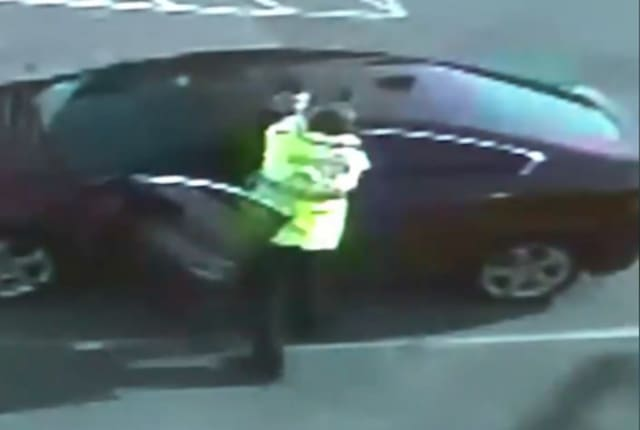 A still from the distributed video, depicting Officer Ian Kosky pinning a man against his vehicle during a traffic stop.