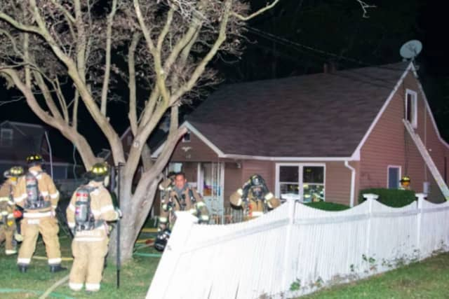 Firefighters working to extinguish the blaze