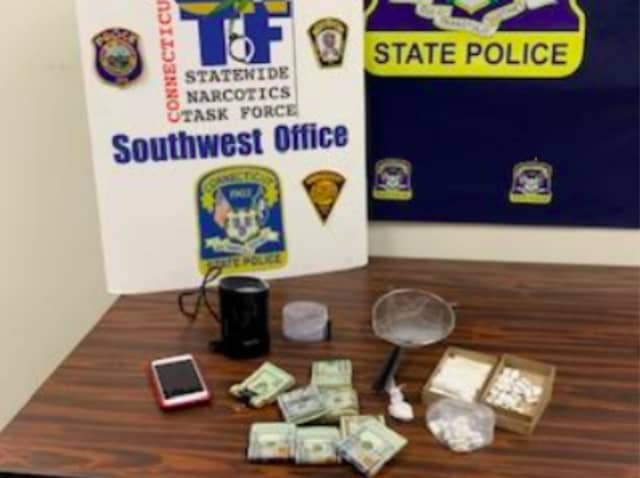 A photo of the confiscated cash and narcotics.