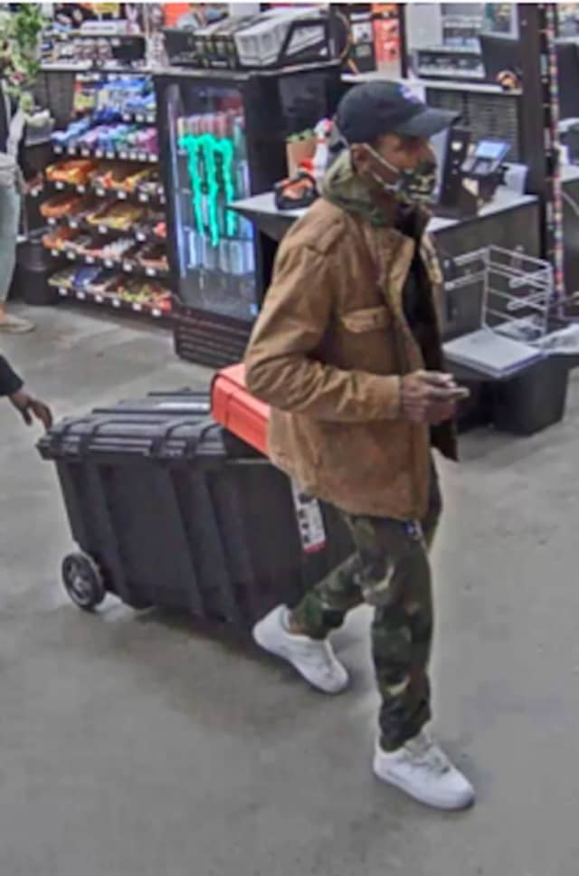 A photo of the man, who is wanted after filling a storage bin with DeWalt tools and attacked a store employee with pepper spray before leaving a Home Depot location without paying.
