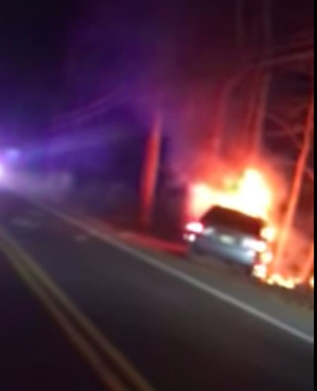 A Howell police officer rescued a driver from this fiery crash.